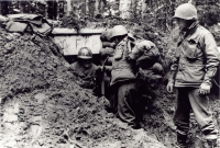 Soldiers took cover in dugouts near Bruyeres [U.S. Army Signal Corps]