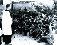 Chaplain Yost conducts church services in Orciano, Italy, July 1944 [U.S. Army Signal Corps]