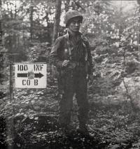 Sgt. James Kawashima (Honolulu) standing guard near Co. B command post at Bruyeres, France.  [U.S. Army Signal Corps]