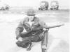Tadayoshi Hamasaki poses with his rifle. [Courtesy of Mary Hamasaki]