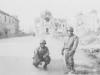 Tadayoshi Hamasaki and fellow soldier pose in the streets of Cassino, 1944. [Courtesy of Mary Hamasaki]