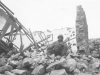 A soldier sits on rubble in Cassino, Italy, 1944. [Courtesy of Mary Hamasaki]