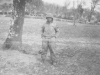 Soldier stands near a tree in camp, Italy. [Courtesy of Mary Hamasaki]