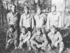 100th Battalion soldiers pose for a photograph in the forest. [Courtesy of Mary Hamasaki]