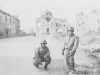 Tadayoshi Hamasaki and fellow soldier pose in the streets of Cassino, 1944. [Courtesy of Mary Hamasaki]