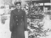 Tadayoshi Hamasaki poses in front of a Christmas tree in La Crosse, Wisconsin, November 28, 1942. [Courtesy of Mary Hamasaki]