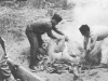 Soldiers prepare the pig to roast after their reception in Maui. [Courtesy of Mary Hamasaki]