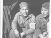 Henry Nakasone and his friend, Paul Kusunoki sit at the entrance to their shelter. [Courtesy of Henry Nakasone]