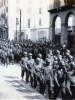 """1945 Parade in  Lecco, Italy.  Here comes """"Charlie Company""""!  (Courtesy of Dorothy Inouye)"""
