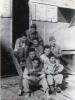 "Higa Noboru, ? Kitagawa, Martin Iida, Hagio, ""Kat"" Funamura.   1943  Hut Entrance, Camp Shelby, Miss.  (Courtesy of Dorothy Inouye)"