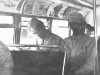 I'm busy reading news.Stanley eyeing beautiful miss. On top deck of Chicago's double deck bus. (L) Tom Ibaraki, ( R) Stanley ___. [Courtesy of Dorothy Ibaraki]