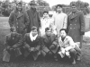 At Madison after football game. Later ate at ?'s home, sleep at Tom's house. All from Hawaii, attending U of Wisc. Standing - Jim Ching, Francis Moy, Sonny Tom. Kneeling: Frances Tom Sept.26,1942. (L Standing) Tom Ibaraki. [Courtesy of Dorothy Ibaraki]