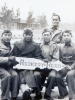 """5 soldiers sitting at pier holding sign """"Rookery Road"""".  [Courtesy of James Nogawa]"""