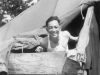 Masanobu Eugene Kawakami in tent with wooden boards for protection when it snows and rains. 8-30-42. [Courtesy of Joanne Kai]