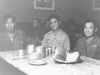 Conrad Kurahara (middle) with friends at dinner in Italy. [Courtesy of Jane Kurahara]
