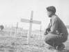 Conrad Kurahara pays his respects at a graveyard in Italy. [Courtesy of Jane Kurahara]