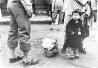 An American child of Japanese descent is tagged for incarcration in Los Angeles, California [Visual Communications Archives, Los Angeles]