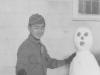 Nov. 29, 1942 at Camp McCoy, Wis.  I built you a snowman.  [Courtesy of Jan Nadamoto]