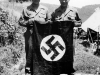 Two soldier hold the nazi flag [Courtesy of Fumie Hamamura]