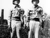 Stanley Hamamura and Sueo Noda with gas masks, in Hawaii, winter 1942 [Courtesy of Fumie Hamamura]
