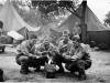 Kaoru Naito, Calvin Shimogaki, Suyeoshi and Hisashi Komori warming themselves by a fire at Camp McCoy in June 1942 [Courtesy of Fumie Hamamura]