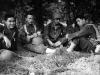 Morihara, Miyashiro, Stanley Hamamura, and Hirokawa resting after a hike at Camp McCoy, July 1942 [Courtesy of Fumie Hamamura]