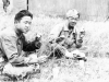 Shigeru Ushijima from Hilo and Ed Ikuma eat lunch during a break at the firing range at Camp McCoy, Wisconsin, August 1942 [Courtesy of Edward Ikuma]