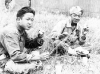 Shigeru Ushijima from Hilo and Ed Ikuma eat lunch during a break at the firing range at Camp McCoy, Wisconsin, August 1942 [Courtesy of Edward Ikuma]
