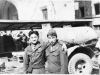 Conrad Kurahara (left) and a friend pose in front of a Go For Broke truck in Italy [Courtesy of Carol Inafuku]