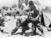 Two soldiers spar with boxing gloves in Lecco, Italy, July 1945 [Courtesy of Carol Inafuku] Inscription: Reverse: Lecco July 1945