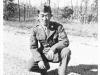 James Kawashima in dress uniform kneeling in a field [Courtesy of Alexandra Nakamura] Inscription: your brother, James
