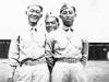 James Kawashima, Harold Sugiyama, and a friend, standing in front of Schofield Barracks, Hawaii [Courtesy of Alexandra Nakamura]