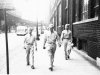 Pvt. Okuma, Pvt. Ono & Pvt. Kihara walking along a Chicago street while on furlough [Courtesy of Alexandra Nakamura] Inscription: Chicago, Pvt. Okumo(Okuma), Pvt. Ono, Pvt. Kihara