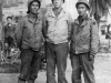 James Kawashima (far right) with friends standing in front of a monument in Italy, December 1943 [Courtesy of Alexandra Nakamura]