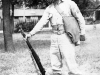Sonsei Nakamura Standing at Attention with rifle at Camp McCoy, Wisconsin [Courtesy of Sonsei Nakamura]