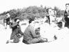 Taking a break during a manuever. 3rd from left: Fred Nakamura, ?, Ogata. [Courtesy of Sonsei Nakamura]