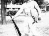 Sonsei Nakamura standing with rifle in hand, Camp McCoy, Wisconsin [Courtesy of Sonsei Nakamura]