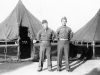 Sonsei Nakamura, and Daniel Wada standing in front of their tents at Camp McCoy, Wisconsin [Courtesy of Sonsei Nakamura]