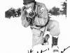 Hank Nakamura eating snow at Camp McCoy, Wisconsin [Courtesy of Goro Sumida] Inscription: To Goro, Best regards and Aloha, Hank Nakamura
