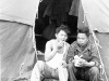 Yoshito Morikawa and Richard Yamamoto eating in front of their tent at Camp McCoy, Wisconsin [Courtesy of Goro Sumida] Inscription: Yoshito Morikawa, Richard Yamamoto. Reverse: Yoshito Morikawa, Richard Yamamoto