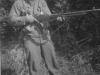 Nakama posing with gun. [Courtesy of Mrs. William Takaezu]