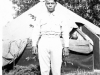 William Takaezu poses in front of a tent at Camp Shelby, Mississippi. [Courtesy of Mrs. William Takaezu]