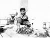 William Takaezu with Mullet fish on Cat Island, Mississippi. [Courtesy of Mrs. William Takaezu]