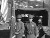 William Takaezu and fellow soldier pose with Regimental flag in Menton, France. [Courtesy of Mrs. William Takaezu]