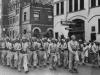 A Co. Parades in La Crosse, Wisconsin in connection with Bond sale Promotion with Abbot an Costello. Parade is led by Capt. Jack Johnson.  [Courtesy of Janice Uchida Sakoda]