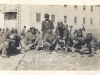 Shinyei Nakamine digs with a shovel with other soldiers while building the barracks at Camp McCoy, Wisconsin.