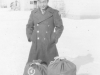 Tom Matsumura with his bags on his last day at Camp McCoy, Wisconsin. [Courtesy of Florence Matsumura]