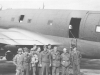 The MIS company poses next to a transport plane. [Courtesy of Florence Matsumura]
