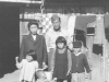 Tom Matsumura with a Japanese family. [Courtesy of Florence Matsumura]