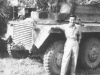 Tom Matsumura poses with a tank while stationed in the Philippines. [Courtesy of Florence Matsumura]